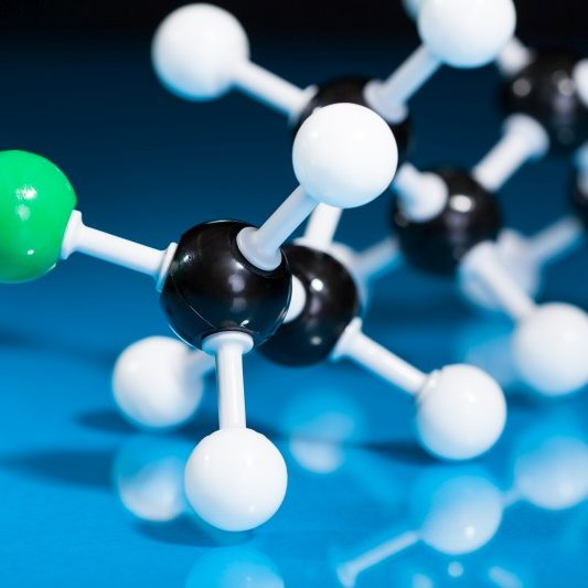 Model of molecular structure on blue reflective background
